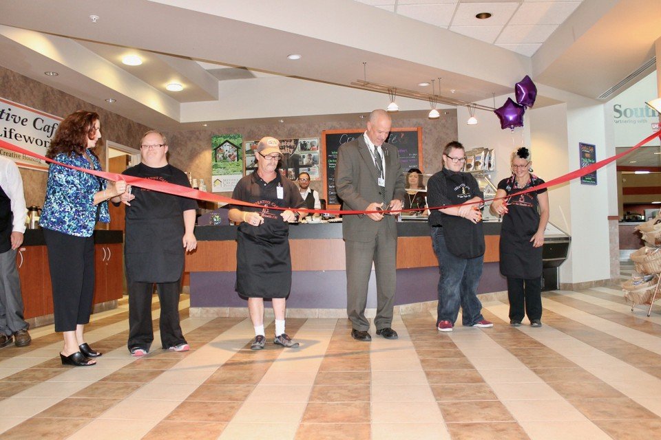 a picture of the ribbon cutting for the creative living cafe at lifeworks